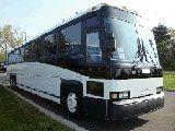 MCI Motorcoach  › 47 Seat Capacity Motor-coach › Air-Conditioning › Large Luggage Bays › Washroom facilities › Overhead parcel racks › Reclining Seats › DVD (mutiple screens), CD, PA, ... (no TV)