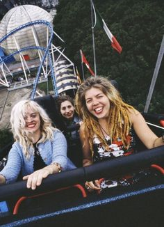 Babes In Toyland on a roller coaster at the Dreamland amusement park, Margate, Kent, July 1992. photographed by Kevin Cummins
