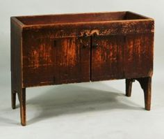 """Early country red painted dry sink, with two doors and high cutout feet, late 18th, early 19th century. 30"""" high, 40 1/4"""" wide, 19 3/4"""" deep."""