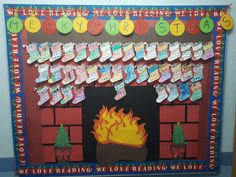 Christmas. Fireplace with a stocking for each elementary student. They did the colouring themselves.
