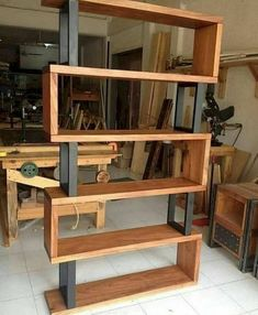 Hardwood and metal bookcase Unique wood & iron # wood working plans Effective Pictures We Offer You About weekend Woodworking Projects A quality picture can tell you many things. You can find the most beautiful pictures Easy Woodworking Projects, Diy Pallet Projects, Woodworking Furniture, Furniture Projects, Furniture Plans, Rustic Furniture, Diy Furniture, Woodworking Plans, Woodworking Classes