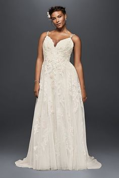 Appliqued with pearl-centered blush flowers, this scalloped-bodice gown has an irresistibly ethereal feel. The tulle skirt is softly voluminous, and the double-strapped, low back lends a delicate feel
