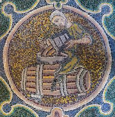 Floor mosaic in a chapel on the north side of the ambulatory, depicting the Labor of the Month for October: making wine. 12th century. Basilica of St. Denis, Paris, France.