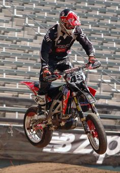 Supermoto...  Dirt with Slicks, riding on a mixed track of both street and dirt segments.