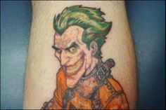 Image from http://comicbookcritic.net/wp-content/uploads/2013/01/joker-straitjacket-tattoo_thumb.jpg.