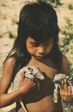 Vintage National Geographic scans.  Kraho boy with armadillos    March, 1959