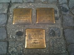 Berlin, Germany. Plates outside of homes say the names of the Jewish families that lived there and at which camp they died.
