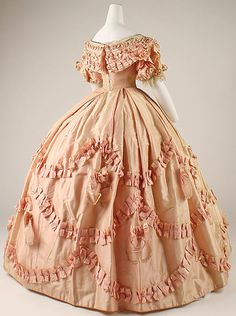 One of the loveliest peach ballgowns ever!  This one is from the Met Museum and dates to around 1861.  #civilwarballgown #victorianballgown