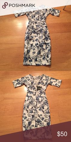 Beautiful midi v back dress. Flower pattern. Petite midi V back dress. Flower print, beautiful material. Classy and classic. I LOVE this dress but it's too tight on me. Never worn. NWT. ASOS Petite Dresses Midi
