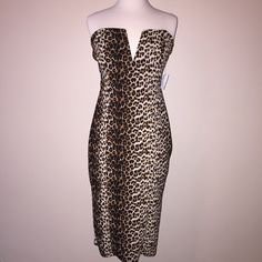 Charlotte Russe Size M strapless dress Charlotte Russe Size M strapless dress. Cheetah pattern. Brand New w tag!!! ***Zipper in the back is missing a few pieces (as seen in picture) so it gets stuck a little bit but zipper still closes. Charlotte Russe Dresses Midi