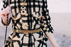 Love how this jacket is styled with gold accessories