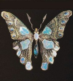 An Art Nouveau butterfly brooch in plique-à-jour enamel, set with opals and diamonds, France,  Ca. 1900.