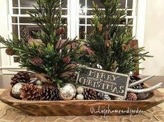 Small trees with pinecones, ornaments, and sign