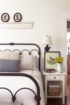 Farmhouse fresh...usually don't like the wrought iron headboards. I'm partial to a wood one, but this is absolutely adorable!
