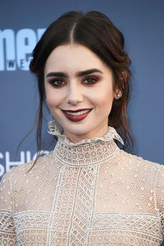 Lily Collins Photos Photos - Actress Lily Collins attends The 22nd Annual Critics' Choice Awards at Barker Hangar on December 11, 2016 in Santa Monica, California. - The 22nd Annual Critics' Choice Awards - Arrivals