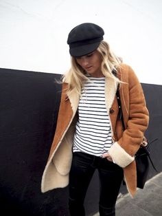 black cap, striped tee, shearling coat, bucket bag and black jeans #style #fashion