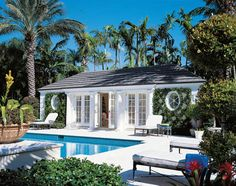 Florida Design Magazine - BRITISH COLONIAL GRACE RECOLLECTED The sapphire waters of the pool beckon, just steps outside the pool house's French doors. The ivy-covered retreat was a necessity for the owner, who enjoys the company of friends and family. Surrounded by stately Royal palms, this lush outdoor setting suits its Palm Beach locale.