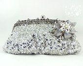OOAK Gorgeous Handmade inspired feather, rhinestones crystal bridal clutch Ivory & White Wedding Purse evening bag. $45.00, via Etsy.