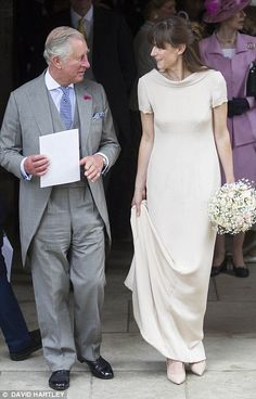 Pictured, Prince Charles chats to a bridesmaid at the wedding of Alexander Knatchbull and Thomas Hooper. - 25 June 2016.