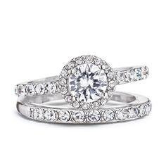 $16.99 or less - Silvertone engagement set with a round 1 carat diamond weight equivalent CZ center stone surrounded by rhinestones.