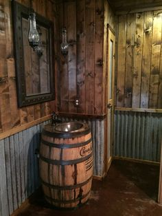 Rustic bathroom. Whiskey barrel vanity. Whiskey barrel sink.