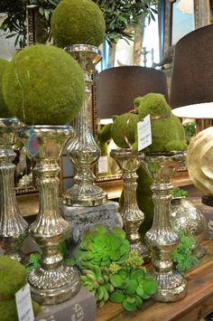 Lovely silver candle sticks and succulents everywhere!