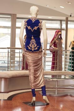 Blue/Golf Dhoti Style Jacket with Churidar - Back Embroidery: Zari & Stone Work Top Fabric: Velvet & Shimmer Dupatta: Net — at Sahil.  For more details and price please contact sales@sahil.com