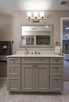 The Dove Gray Vanity In This Full Bathroom Is By Showplace Cabinets.