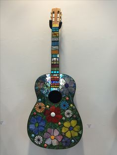 Stained glass mosaic on an old guitar.