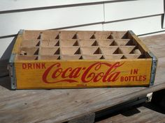 Vintage Yellow and Red Coca Cola Wooden Bottle Crate, have this on the wall as a collection holder.