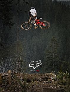 motor bike in the Air but the fox symbol in the back ground