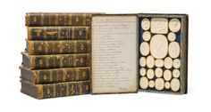 Seven volumes of Paoletti Grand Tour plaster intaglios early 19th century In the form of faux books, each volume titled to spine, enclosing two sets of cameos, titled index page to cover interiors - Dimensions of each volume 10 x 6 1/4in (25.5 x 16cm)