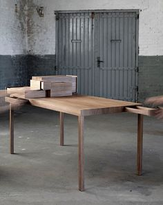 """""""Listen to your hands"""" by Lee Sanghyeok is a desk with drawers. A push of one drawer pulls out another as if in direct conversation with the action."""
