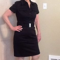 Black, knee length utility style dress Black Calvin Klein dress with belt, silver hardware, and utility styling on top. Calvin Klein Dresses Midi