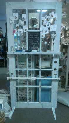 This crackled shabby chic French Door room divider has a message board, Chicken wire, a shelf and towel bar.  It is available at Knot on Main, Dunedin Fl, booth 36, for $148.  D Dunbar, Artist.