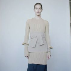 Belting a sweater with a sweater.. what a fabulous idea!  Nonstop Knits: 10 Super Modern Takes on Sweater Dressing, Head to Toe – Vogue