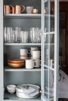 Copper dishware adds warmth and depth to this pretty grey wooden kitchen. http://www.solidwoodkitchencabinets.co.uk