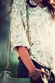 Sequined top paired with a simple pair of shorts and green leather bag. classy!
