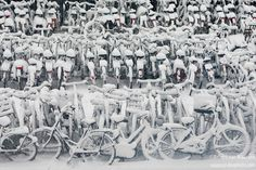 The snow covered bikes of Amsterdam, Holland winter cold weather cycling bike snow http://www.biketalker.com
