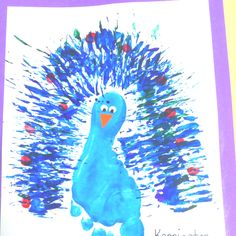Our Preschool Art Project- A peacock made with a footprint, painting with a fork and fingerprints.