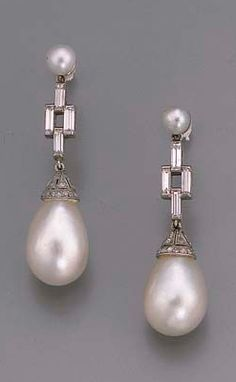 A PAIR OF ART DECO PEARL AND DIAMOND EARRINGS  Each designed as a drop-shaped pearl with diamond-set cap suspended from the baguette-cut diamond four-stone line and single pearl surmount, circa 1920