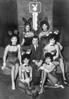 Hugh Hefner surrounded by Playboy Bunnies, 1960s.