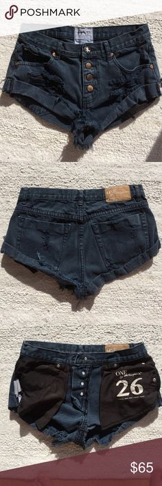 One Teaspoon size26 dark blue shorts One teaspoon: denim. jean shorts with front and back pockets, dark blue, with 4 copper/gold buttons up the front. Size 26, fit like a 27. Perfect condition, worn twice, washed once. Do not fit me anymore. One Teaspoon Shorts Jean Shorts