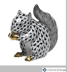 Herend Hand Painted Porcelain Figurine of Baby Squirrel Sitting Up Eating Nut, Black Fishnet w Gold Accents.