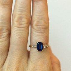 Custom emerald cut sapphire and diamond stone cluster ring by Mociun