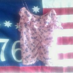 Urban Outfitters Flag Cami USA patriotic July 4th Sheer (see through) ruffle camisole with tiny flags.  Size m Best fits s/m Elastic vertical seams on the front & back give a cute detail - elastic is loose so it doesn't change the shape much Adorable patriotic American flag top. Fun for summer BBQ and beach trips From Urban Outfitters by flat black  Good condition, worn a few times and laundered Urban Outfitters Tops Camisoles