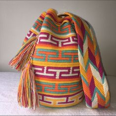 "Multicolor Bohochic tassel crochet bucket wayu bag Beautiful large 100% authentic wayuu bag. Cute multicolors bag with strap and tassels. New. Handmade. Washable. Not dryer.                                        Height 12"" Diameter 9"" Drop lenght 20"" There are not 2 identic bags. Each is one of a kind. Perfect for coachella or festival season. Last picture is for size reference Boutique Bags"