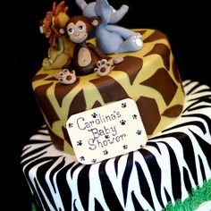 Sweet Memories Bakery animal lovers baby shower cake with hand sculpted fondant animal cake topper to keep and enjoy for years to come