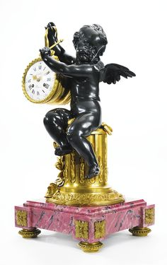 A LOUIS XVI STYLE GILT AND PATINATED BRONZE AND RHODONITE INLAID MARBLE MANTLE CLOCK PARIS, SECOND HALF 19TH CENTURY