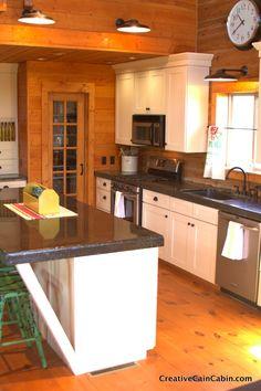 Creative Cain Cabin: White Kitchen in a Log Home